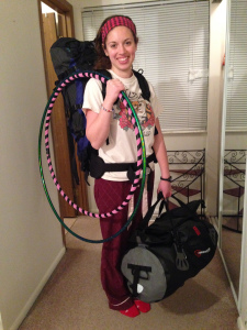 Modeling my hiking backpack, my 70 liter dry-bag duffel, and my hula hoops which are my carry on item (they will be coiled down for the flight). My bags each weigh about 35 pounds- well under the 50 pound weight limit!